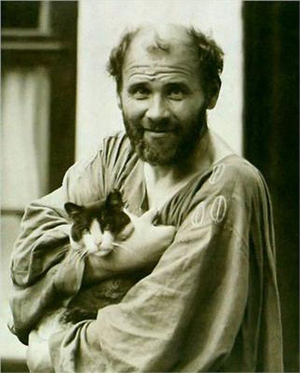 Gustav Klimt holding his cat Katze.