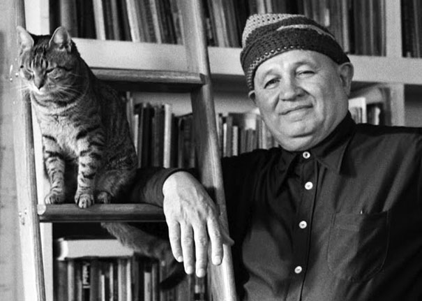Romare Bearden hanging out with his cat, Gippo.