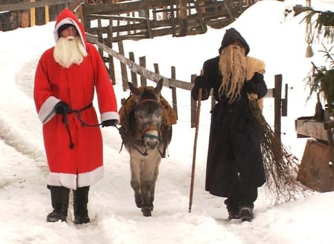Saint Nicholas arrives with Knecht Ruprecht.