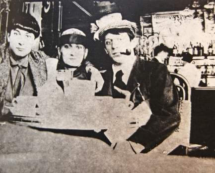 Moise Kisling, Paquerette, and Pablo Picasso at Cafe la Rotonde, 1916.  Photo by Jean Cocteau.
