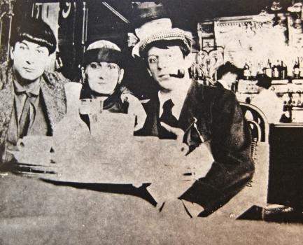 Moise Kisling, Paquerette, and Pablo Picasso at Cafe la Rotonde, 1916. Photo by Jean Cocteau.