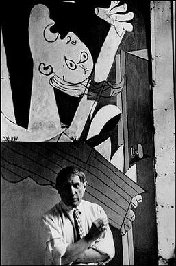 "Picasso in Front of ""Guernica,"" 1937.  Photo by Dora Maar."