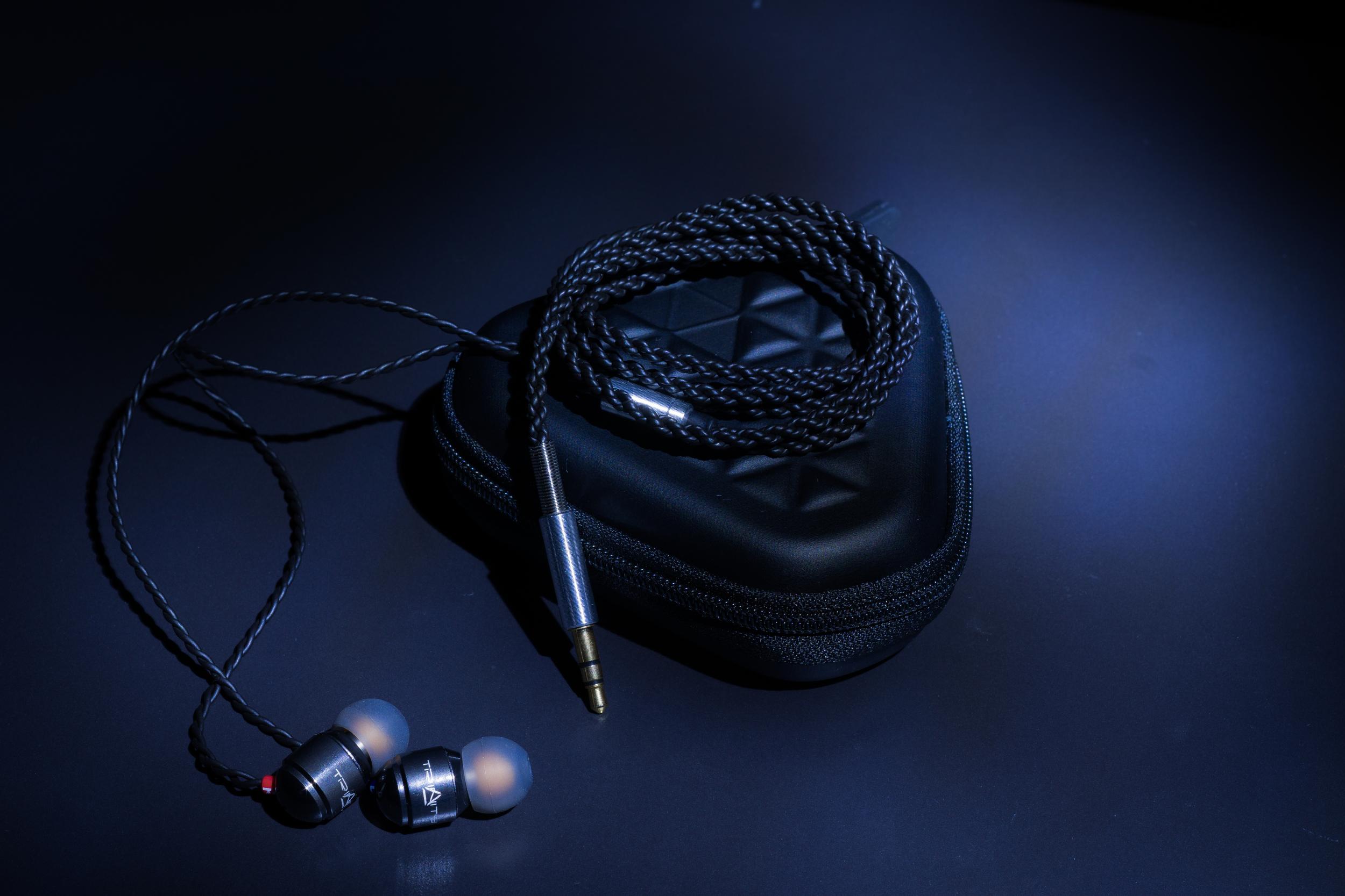 The Trinity Audio Engineering Delta in ear headphones with custom headphone carry case