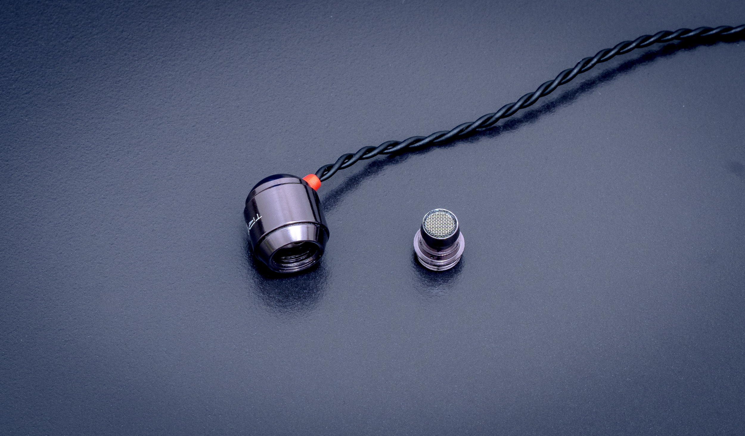 Trinity Audio Delta IEM with custom sound filter removed.