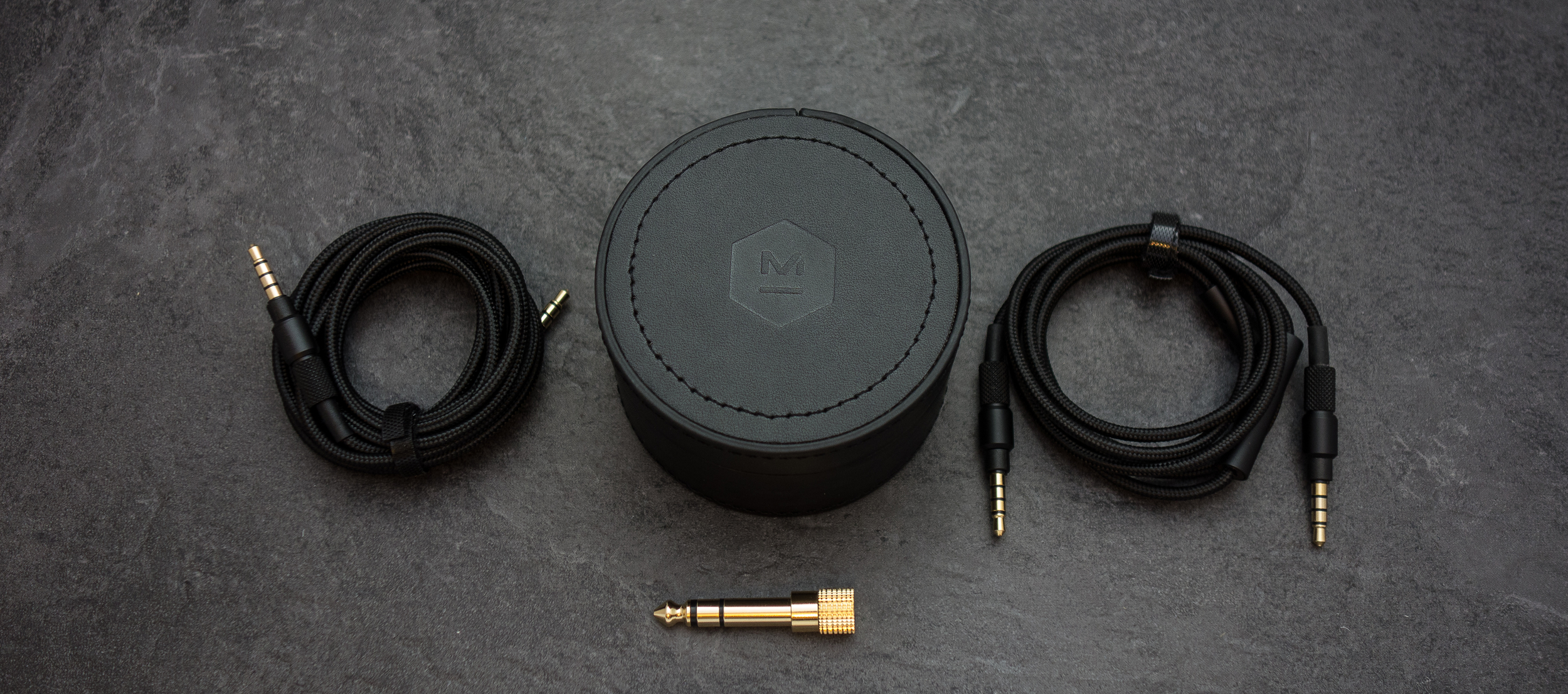 Master and dynamic give you 2 sets of cable one with a mic and inline controls the other being a straight 3.5mm male to male jack cable.