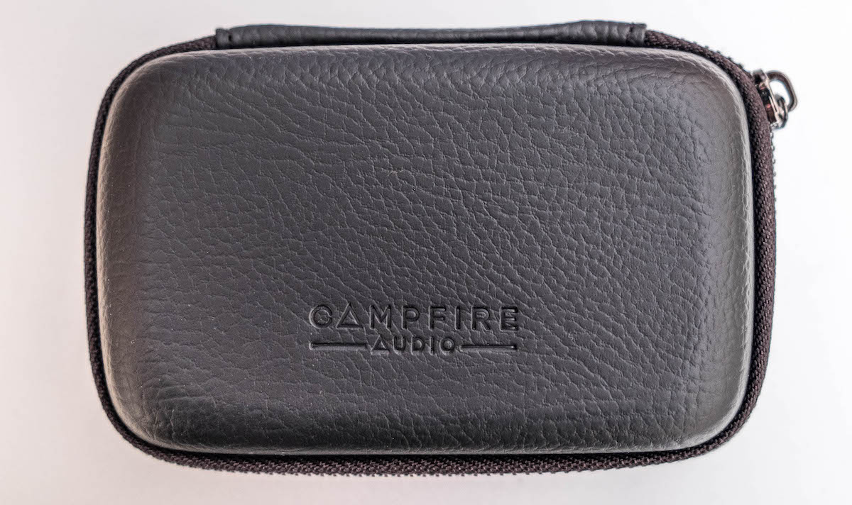 Black leather earphone carry case for the Campfire Audio Dorado earphones. Mid grain leather embossed with the Campfire Audio Logo and a robust zipper.