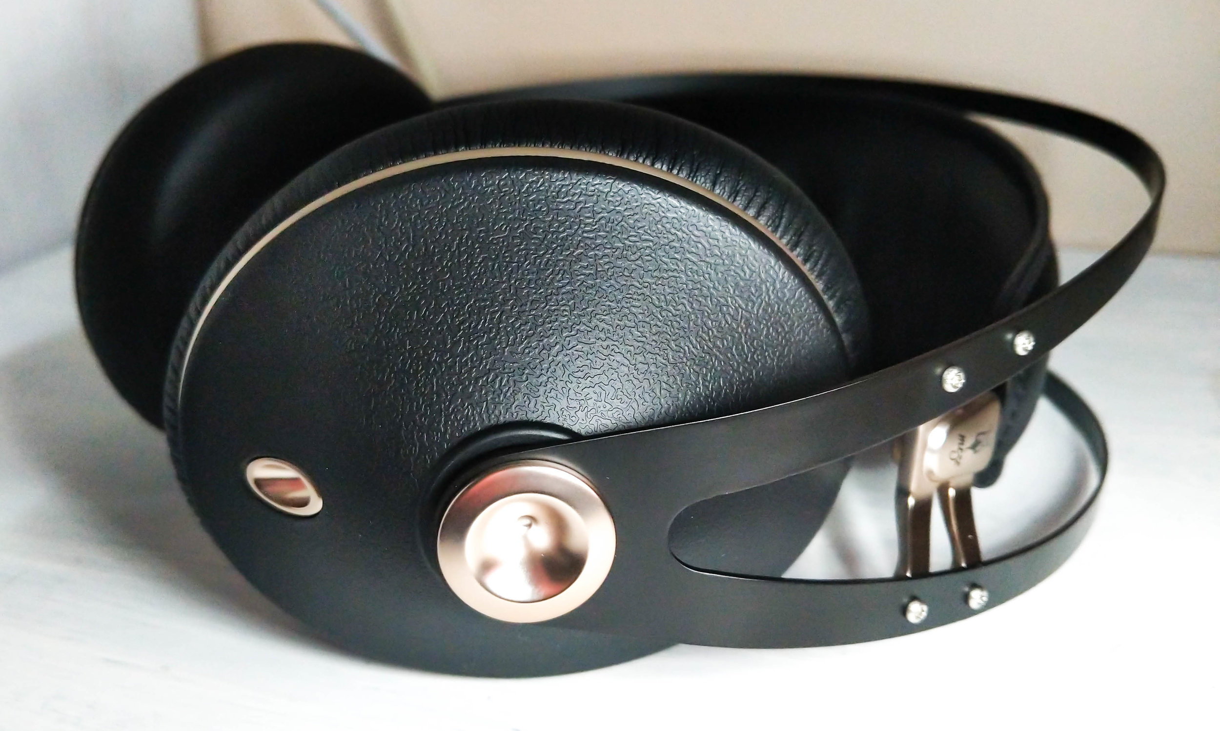 Meze 99 Neo headphones with black and rose gold colour.