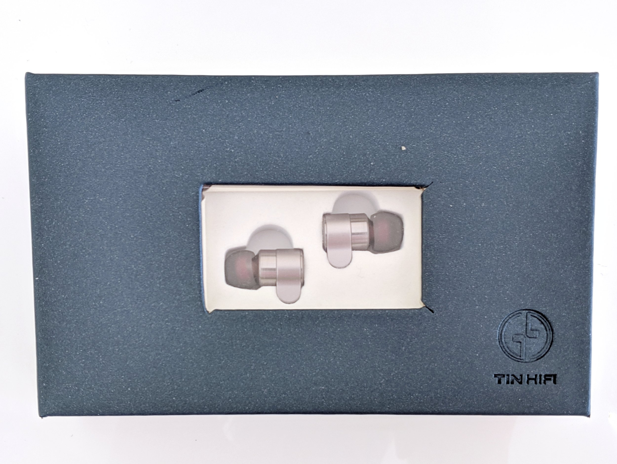 Tin Hifi T3 box with earphones inside.