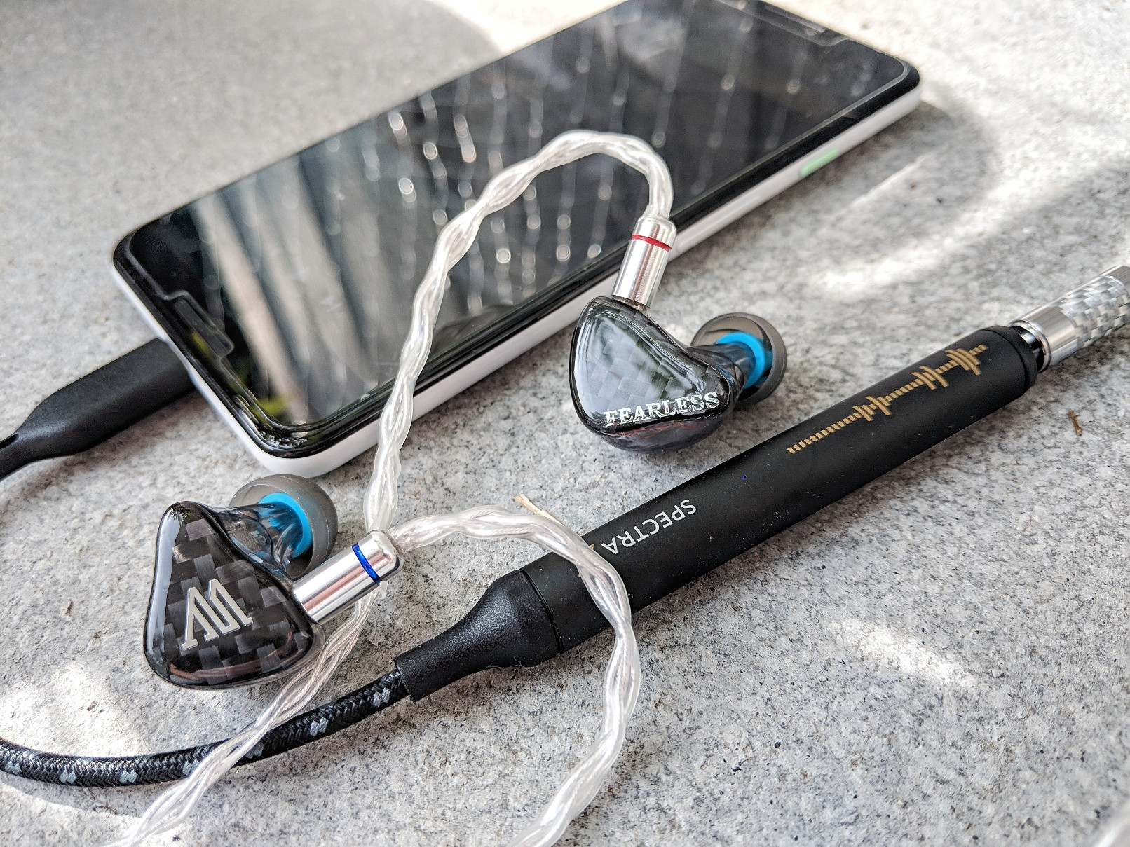 The Nextdrive Spectra X is a DAC and Amplifier designed to be used with a smartphone. In this photo the Spectra X is connected to a Google Pixel 2 and the Fearless Audio S8P
