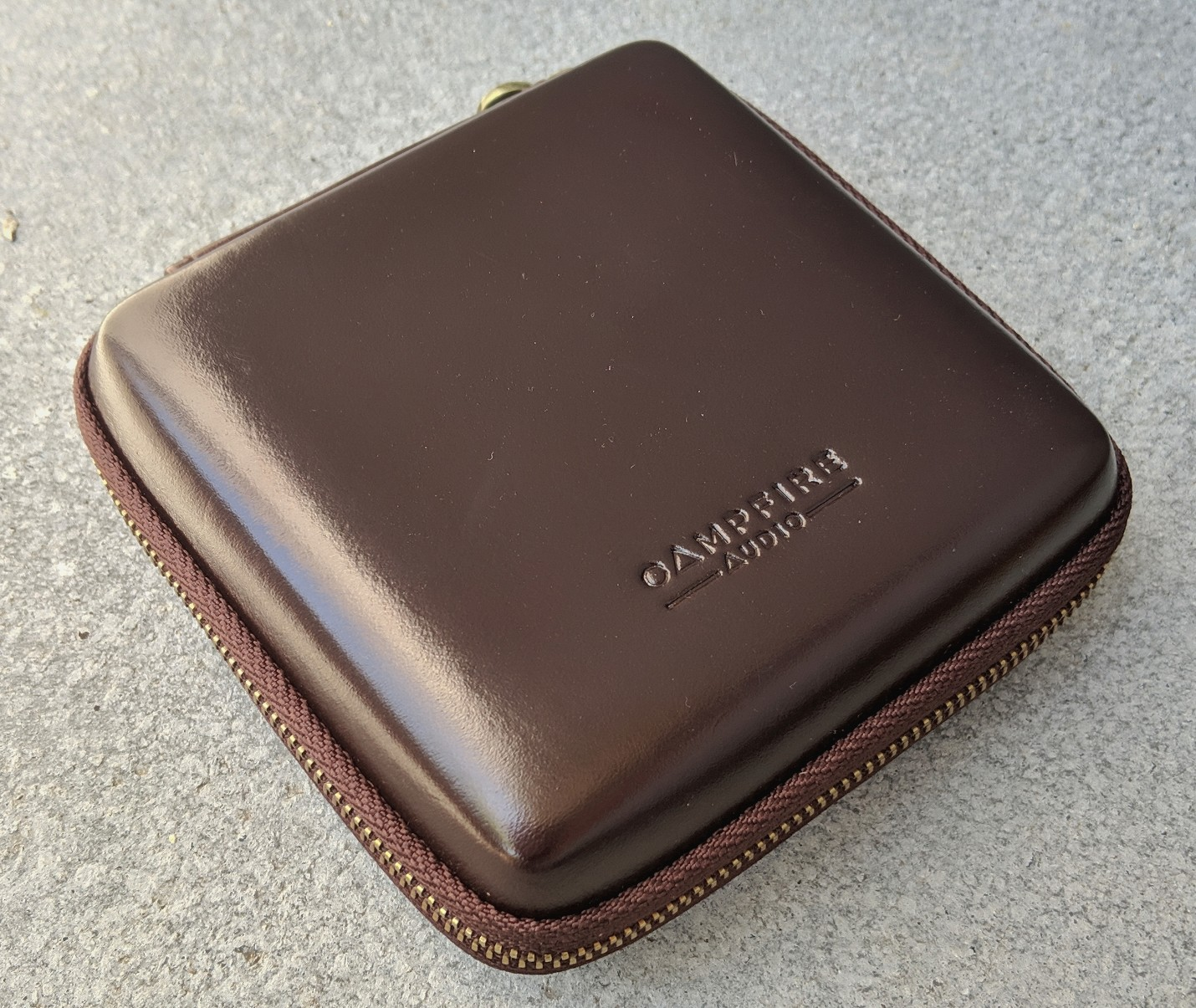 Campfire Audio Solaris leather carry case with brass zipper.