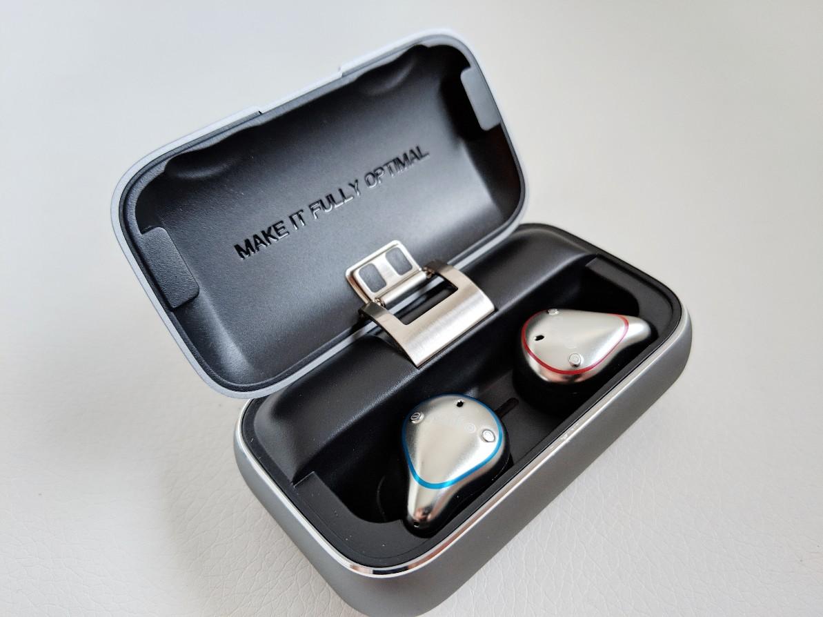 Earphones inside charging case.