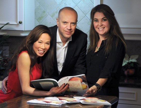 Leanne Chan, Darren Pedersen and JoAnne Strongman flip through their new book, hot off the presses, entitled Health The Way Nature Intended: Your Complete Guide To Eating And Living Well With A Stoma. photo Mike Wakefield, North Shore News - See more at: http://www.nsnews.com/living/new-book-offers-road-map-to-good-health-1.2172359#sthash.rO6mW1y5.dpuf