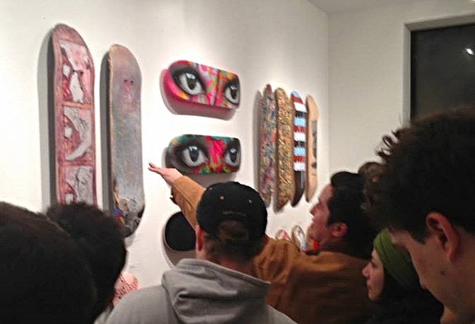 """One More Reason to Be a Superhero""  - SOLD - Skate deck farthest left."