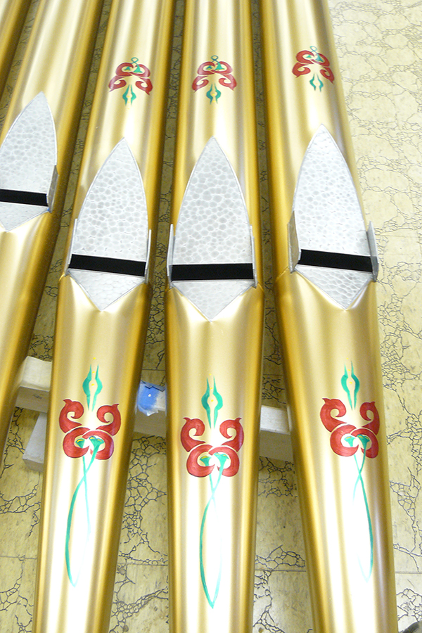 Hand-painted decorative pattern on facade pipes.