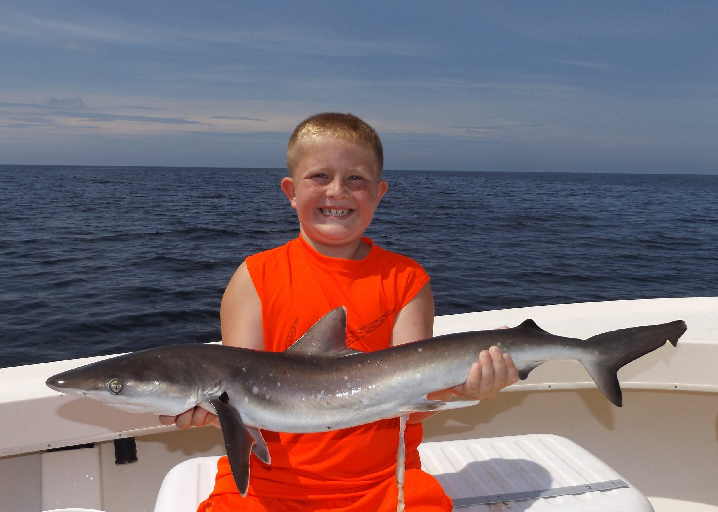Brody ( The Shark KIng) Kelly of Nebraska with his first-ever shark . He was happy? right?