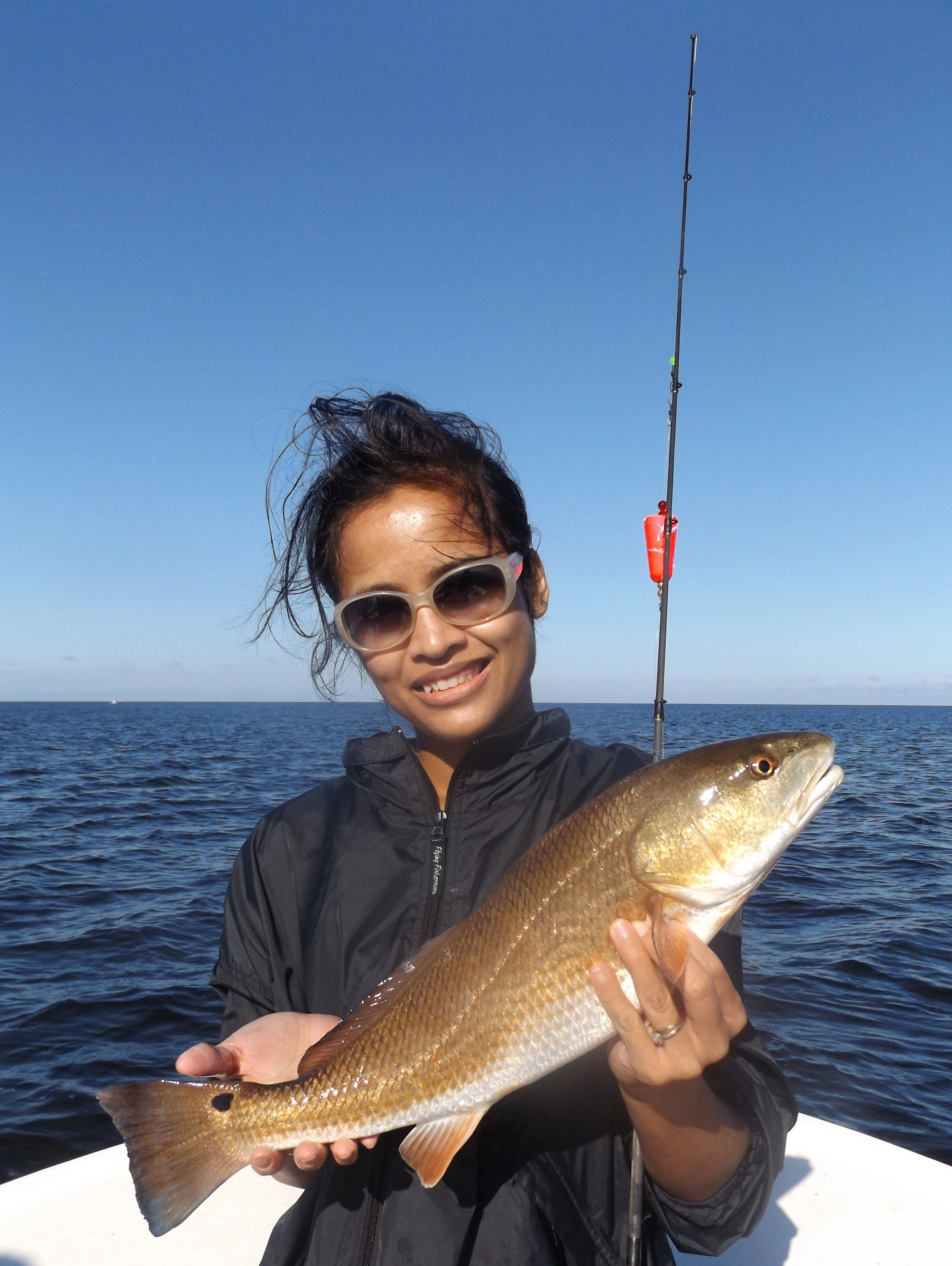 Kasey Mee of Sebring, Fl. with her first -ever redfish!