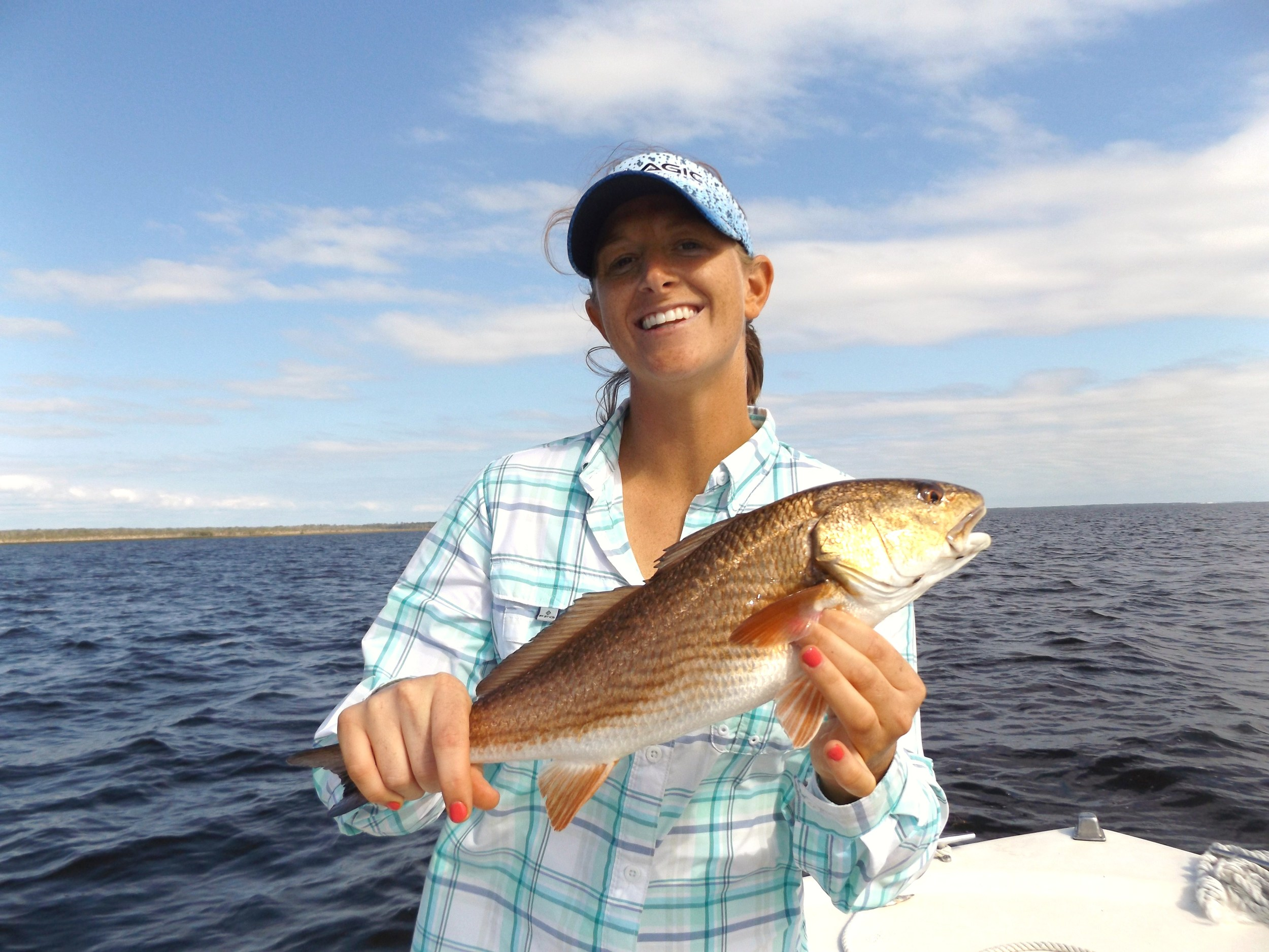 Heather Tucker with her first-ever redfish