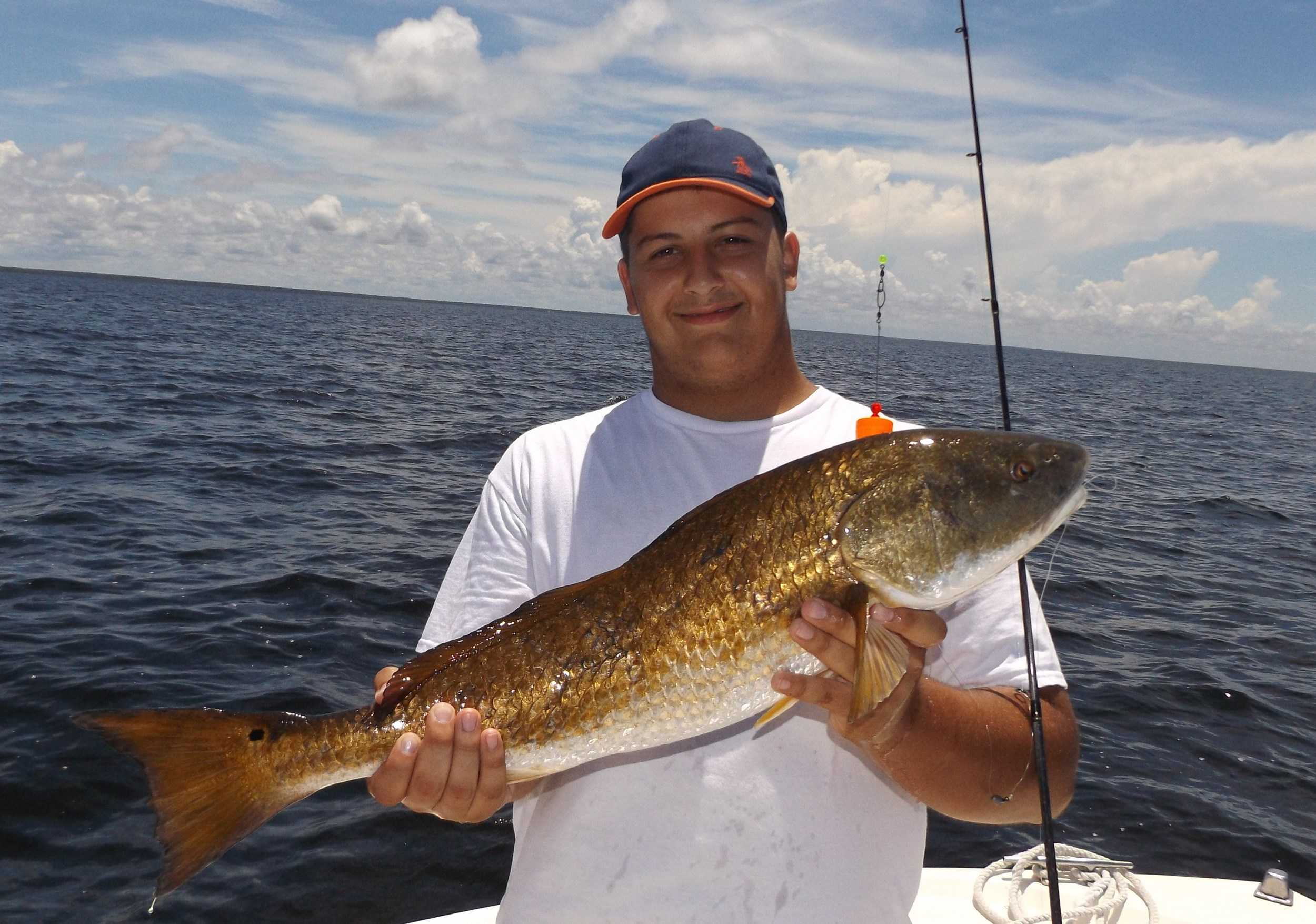 Bailey king of thomasville,ga. with his first-ever redfish