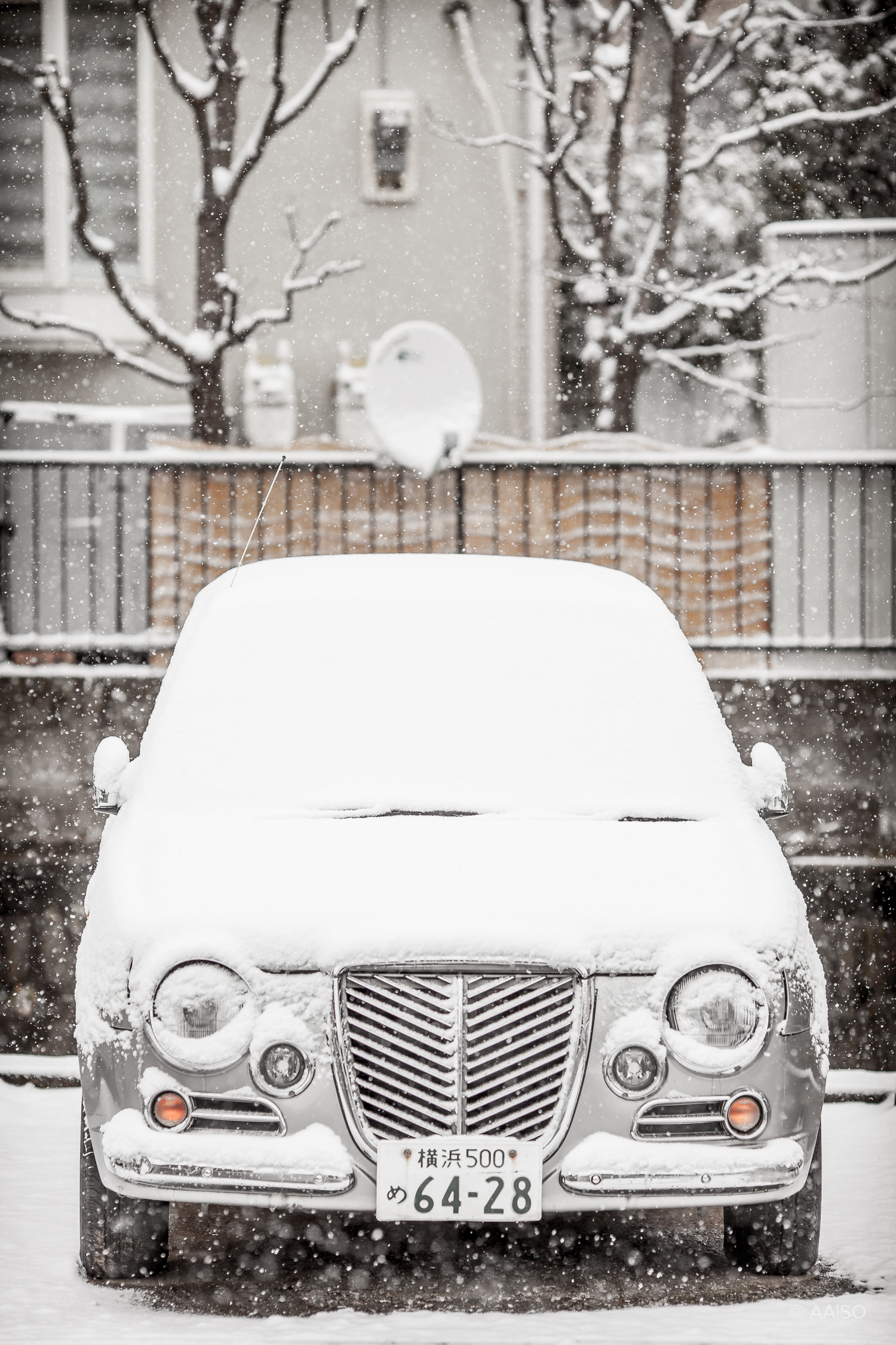 Snow-covered japanese car