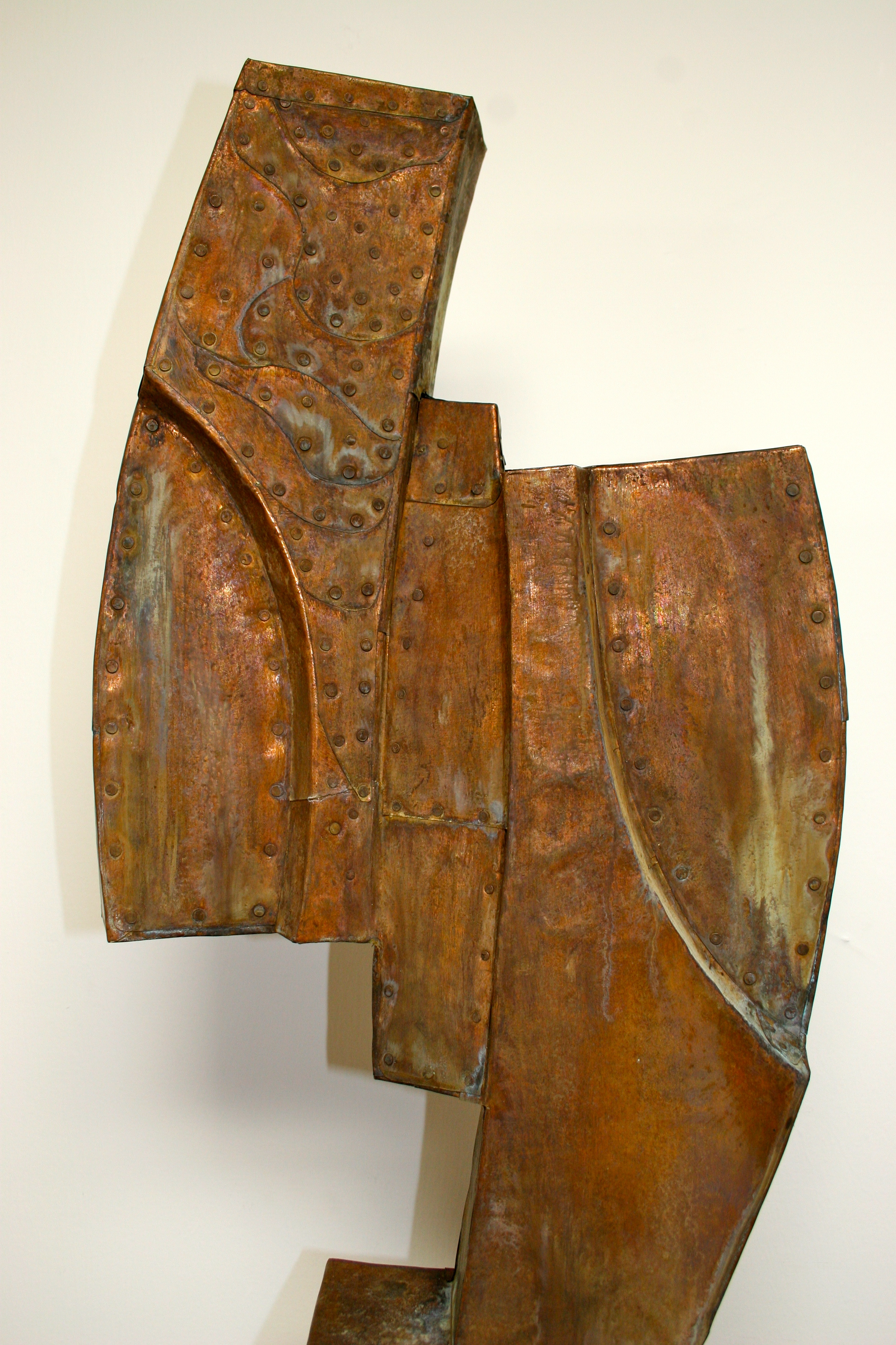 "Captive detail,  Patinated hammered copper over carved wood, 34"" x 19"" x 5"""