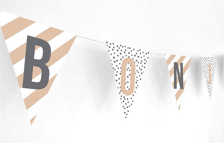 Bunting spelled out Bonjour Bebe.