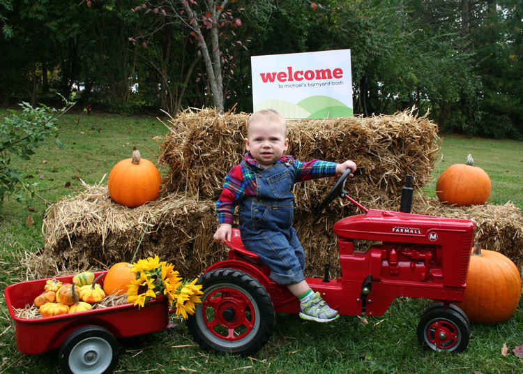 All guests were welcome by this little farmer cruising around in his tractor, hauling pumpkins and picking up babes!