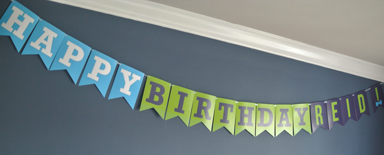 """The """"Happy Birthday Reid"""" Bunting hung above the dining area. I'm sure it made the fried chicken tastethat much better!"""