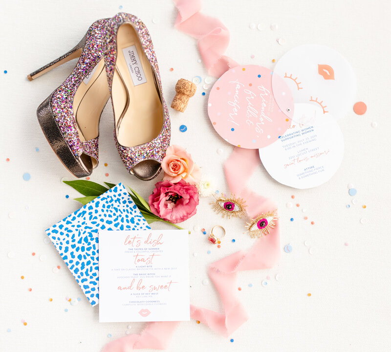 The invitation consisted of three die cut circles - the top featured lashes and lips printed on vellum. It was sealed in a cellophane envelope filled with confetti.
