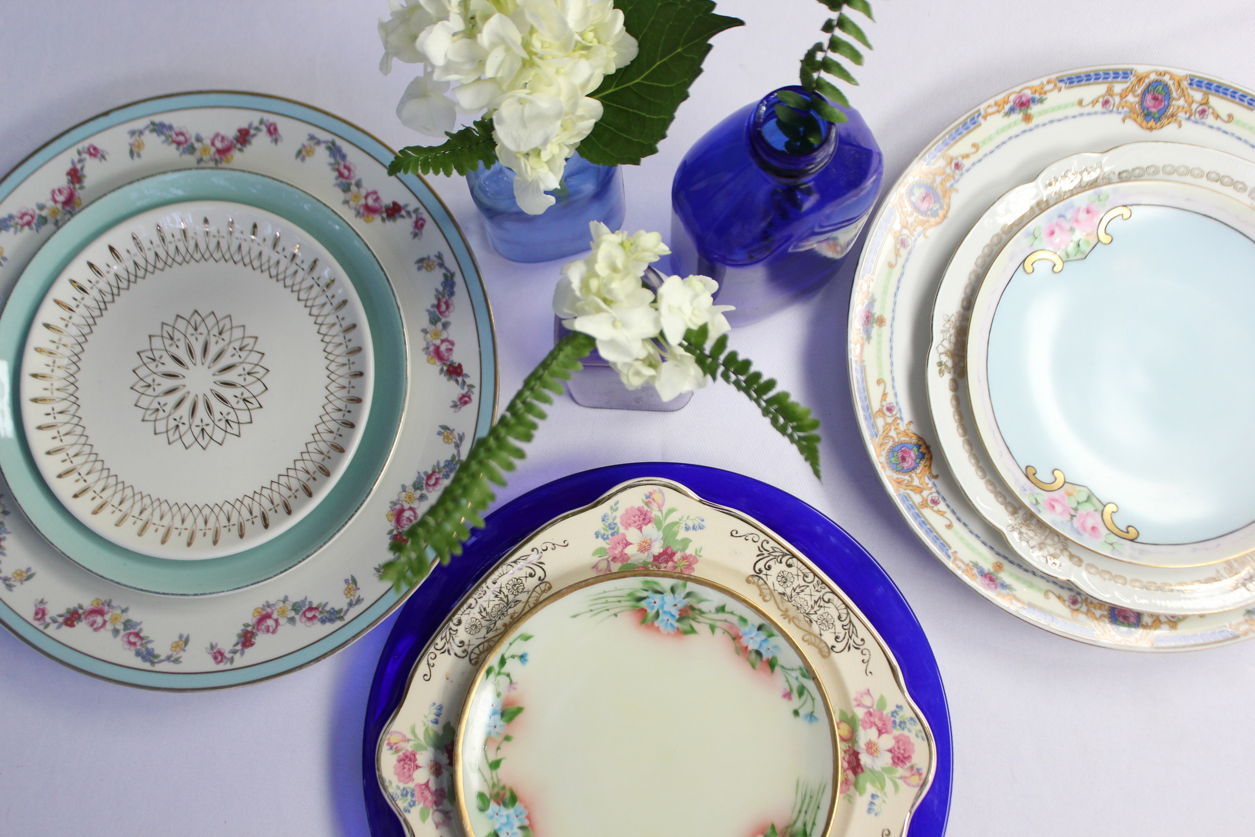 Vintage blue china and Depression glass plates
