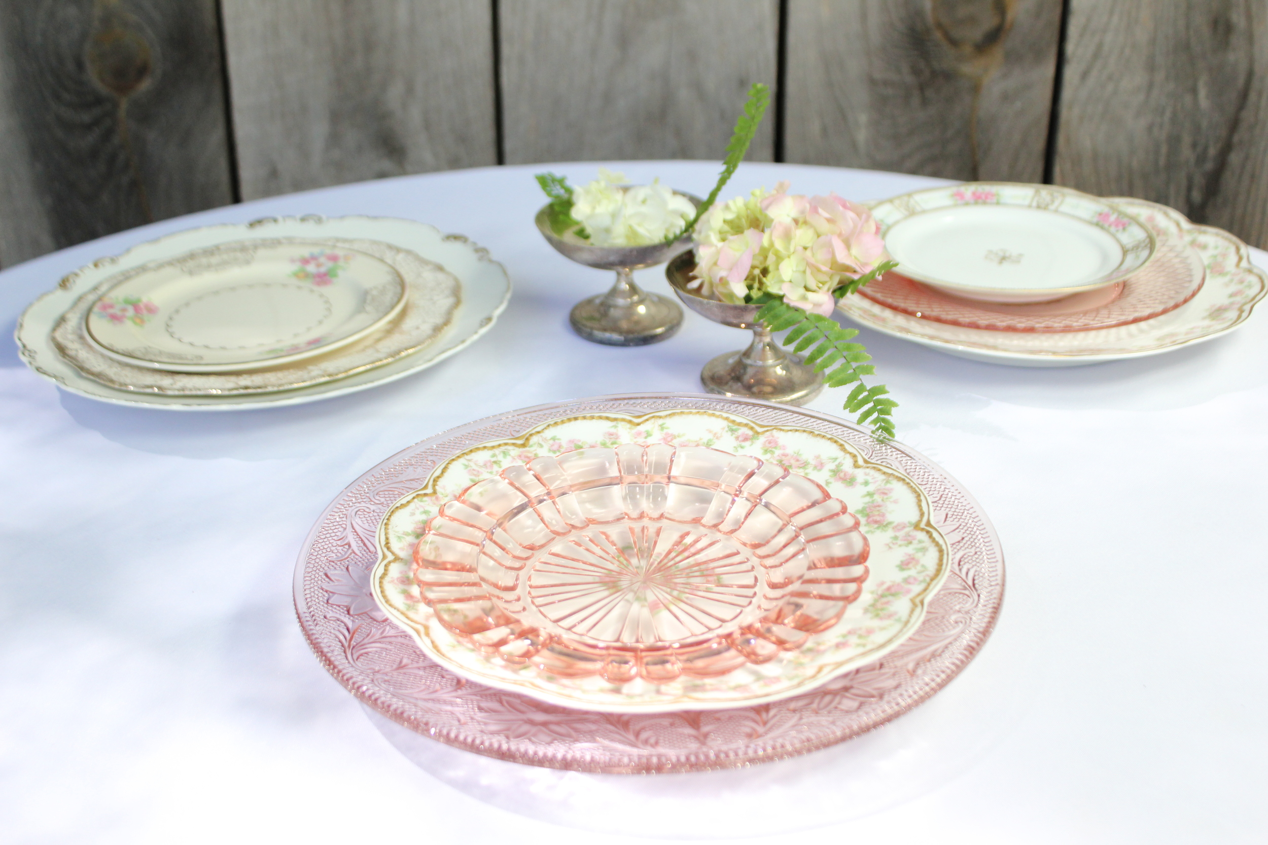 Vintage pink china and Depression glass plates