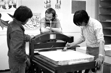 Above: Pitseolak (left) and Wally (centre) leaning on the press. Pee Mikkigak (right) applying the rosin or talc.  Photo courtesy Tessa MacIntosh