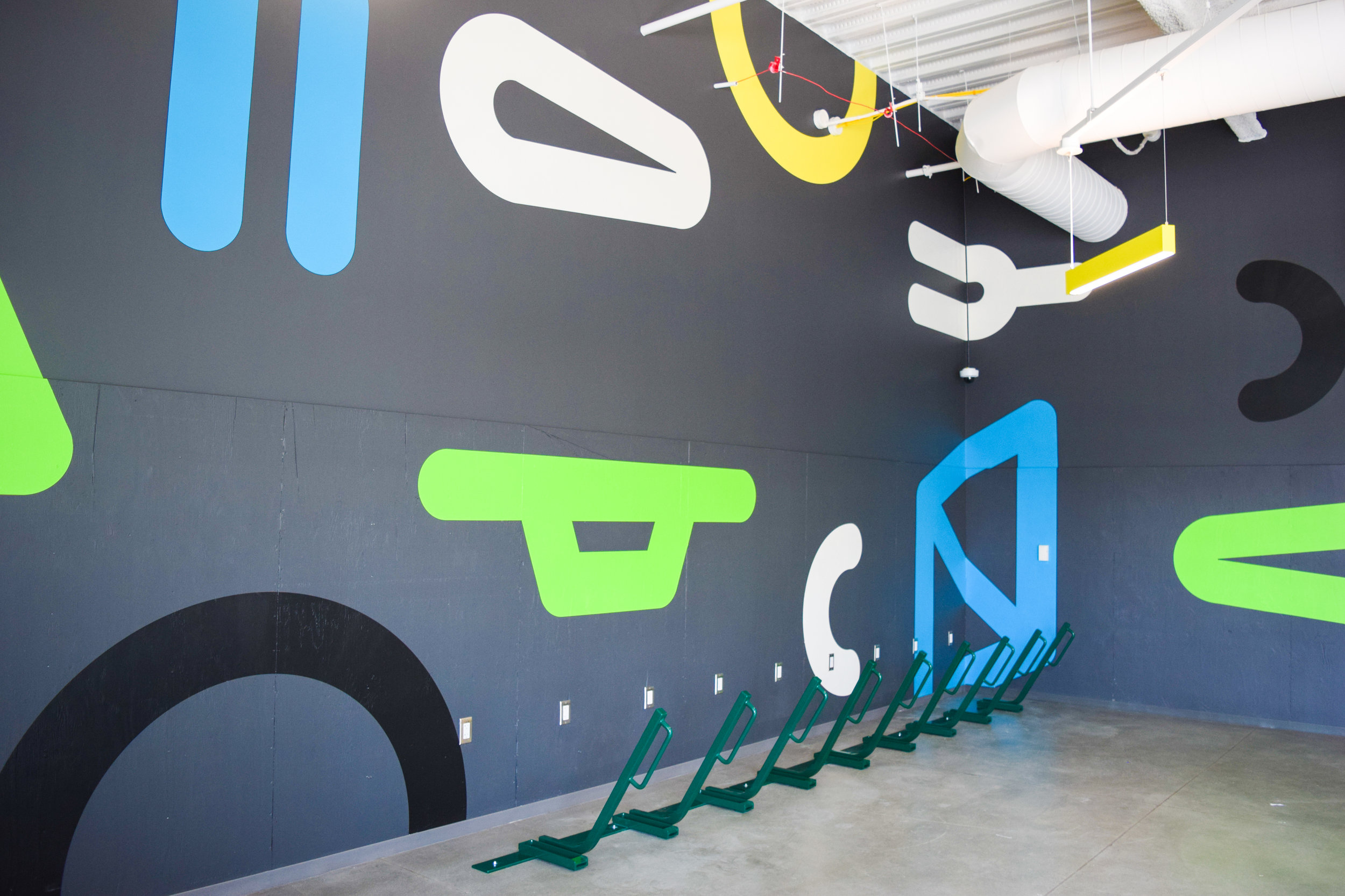 Design of hand-painted wall mural in secure bike storage