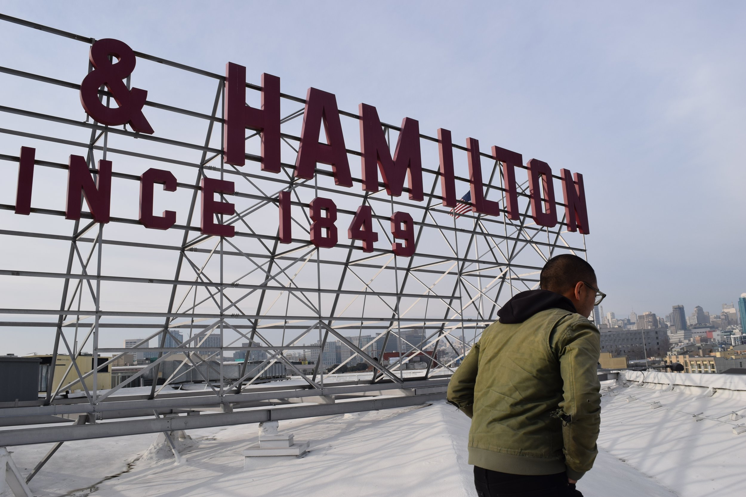 Inspiration for cafe branding & signage: the historic Baker & Hamilton sign atop the building