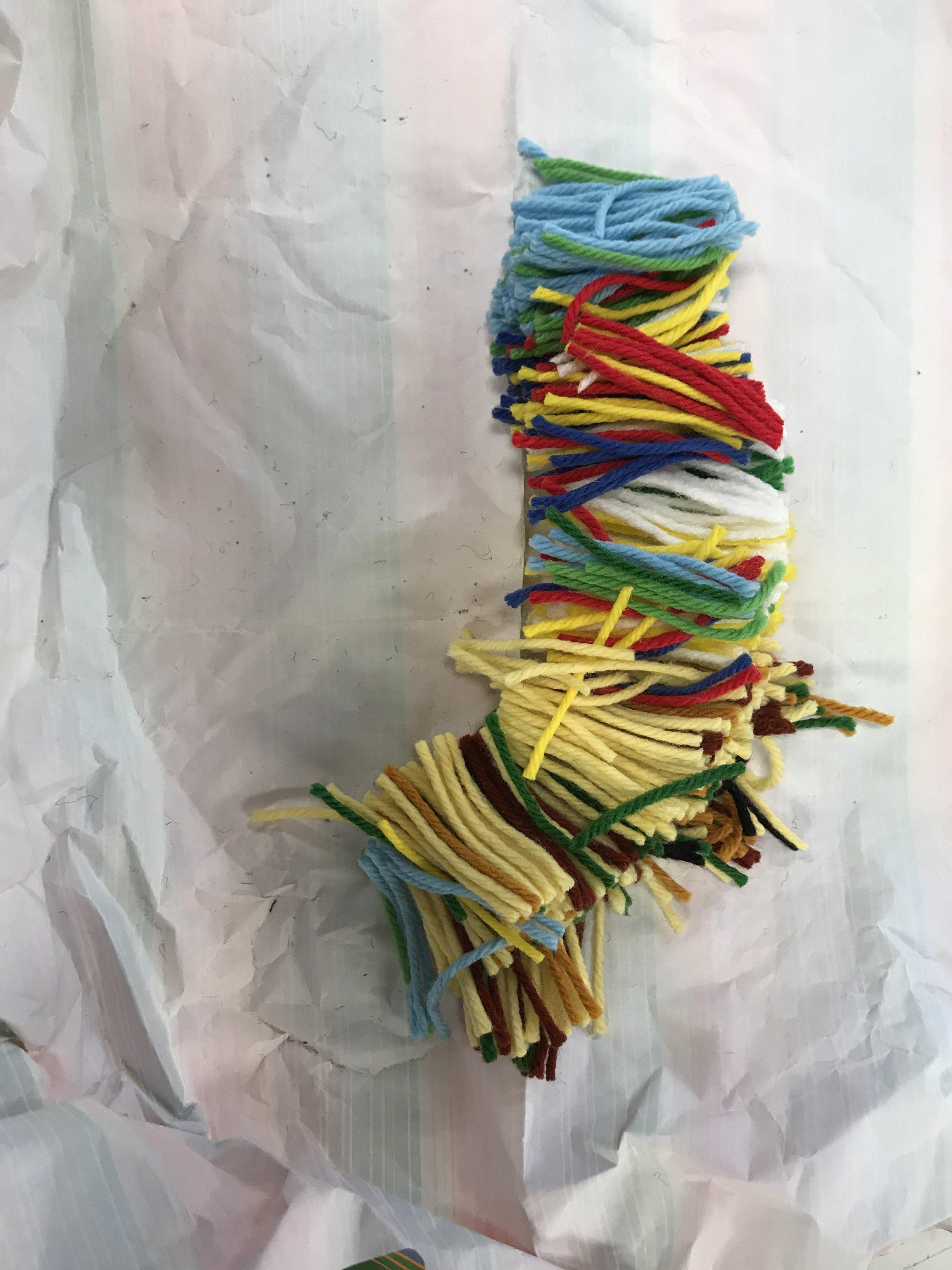 gift 2. a bag full of yarn scraps used for rug hooks.