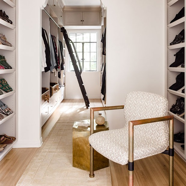 Beautiful space from a beautiful couple @jeremiahbrent and @nateberkus  This walk in closet is PERFECTION !!! Chair upholstered with our Patmos in Mocha 👍🏼👍🏼 #carolinairvingtextiles #patmos #closetdesign