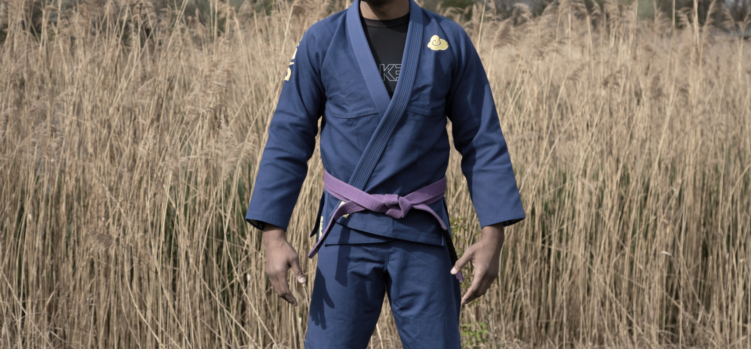 Temple Gi Blue and Temple Rashguard underneath Model: Bryan Thompson IBJJF World Champion