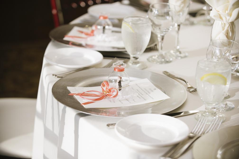 silver and salmon wedding table setting
