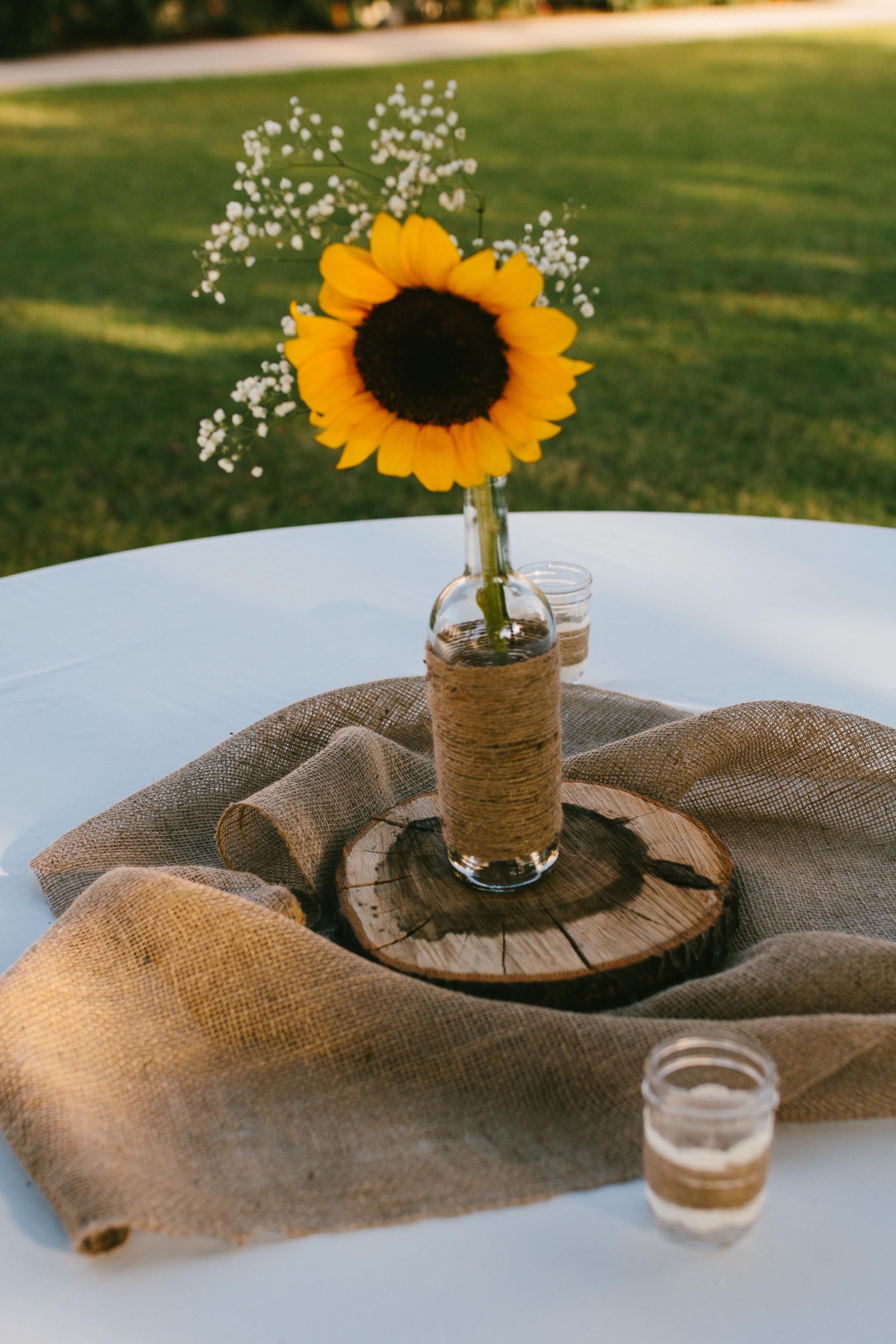 rustic sunflower wedding centerpieces - rustic intimate oklahoma wedding at Darlington Chapel