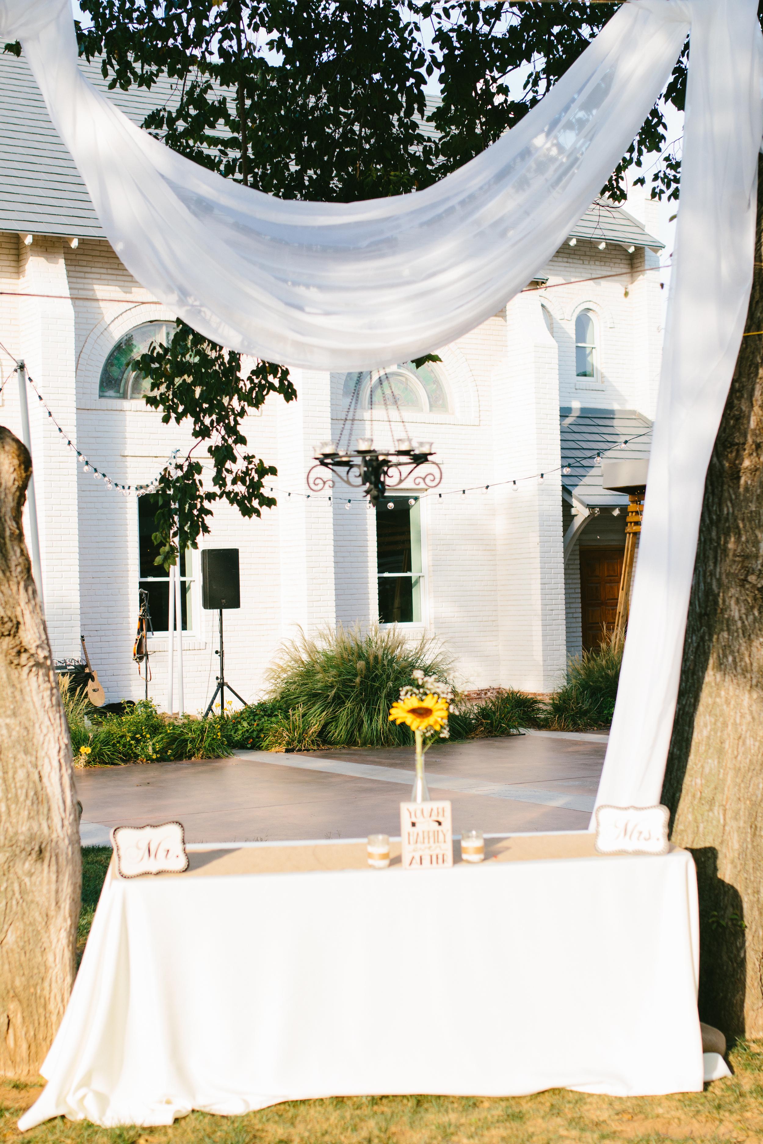 rustic outdoor sweetheart table decor - rustic intimate oklahoma wedding at Darlington Chapel