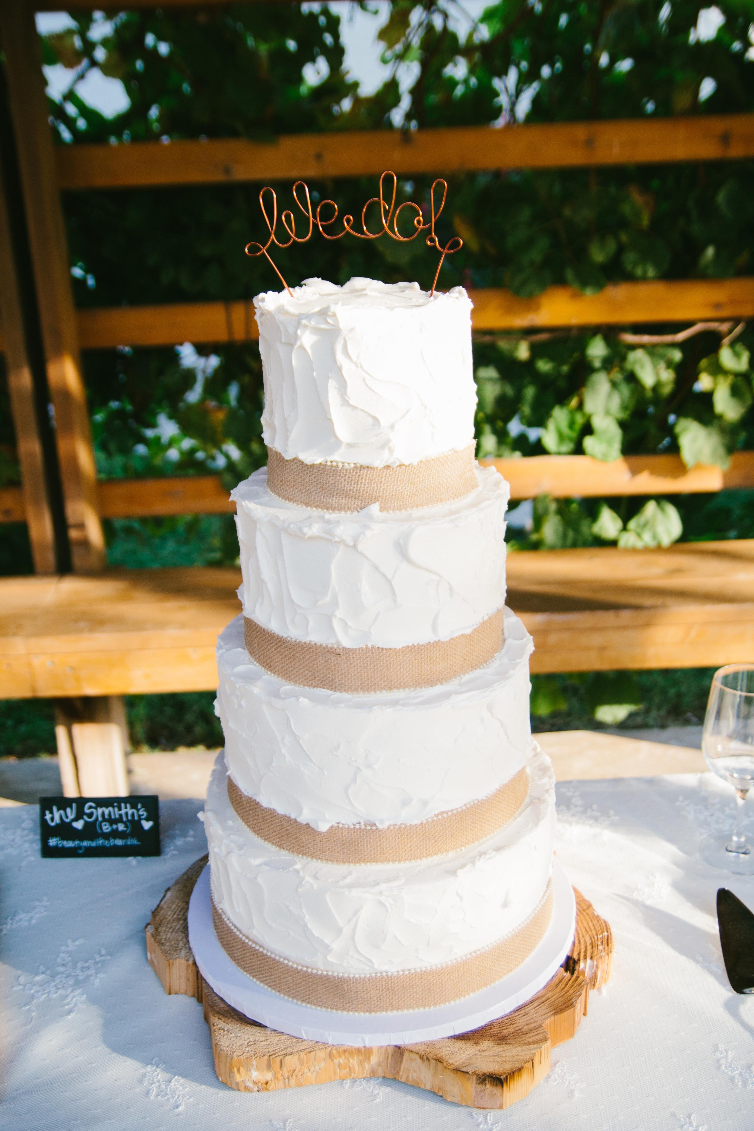 rustic wedding cake - rustic intimate oklahoma wedding at Darlington Chapel