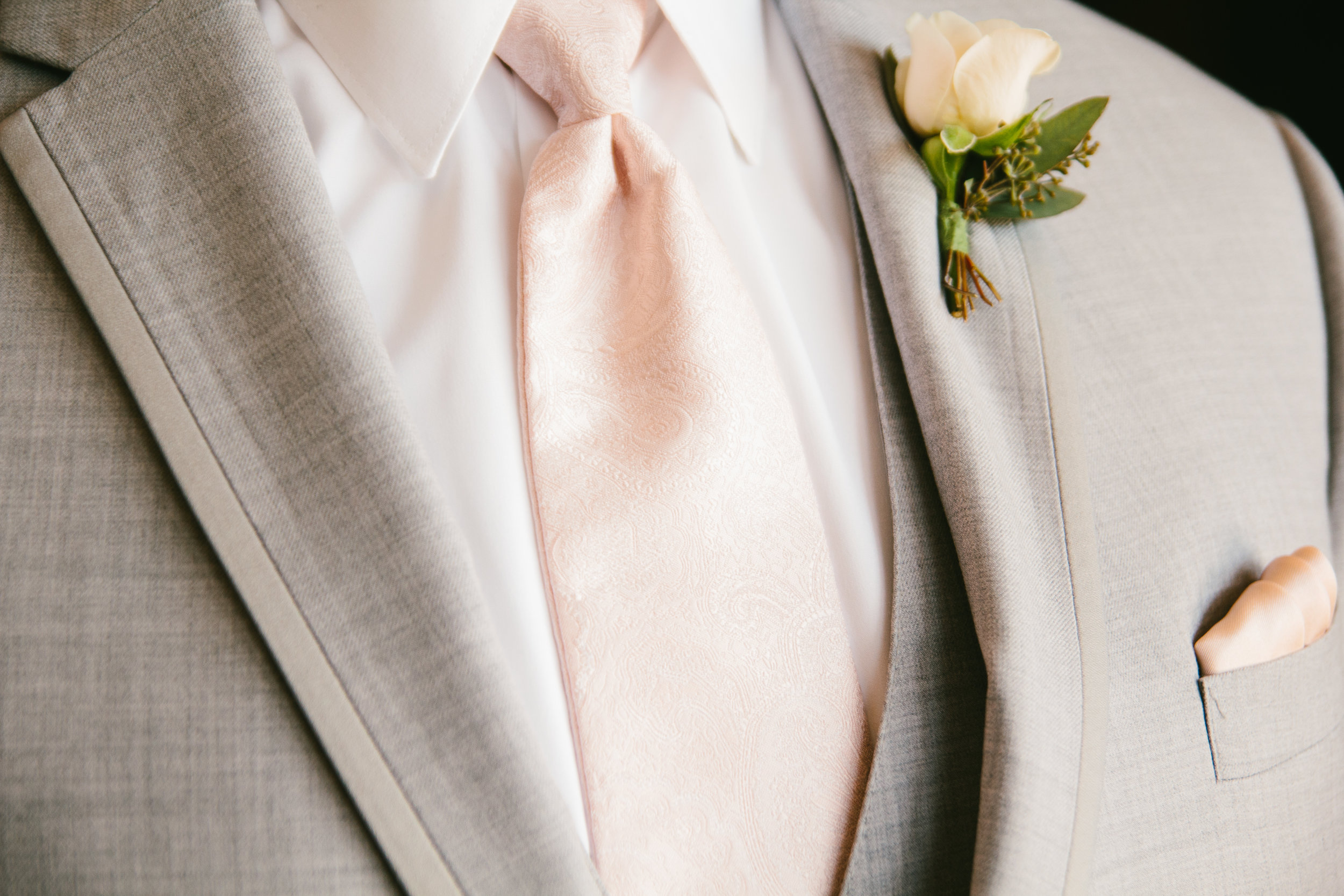 White Rose Boutonniere - A Champagne + Blush Oklahoma Wedding - Meditations Event Center - From Britt's Eye View Photography