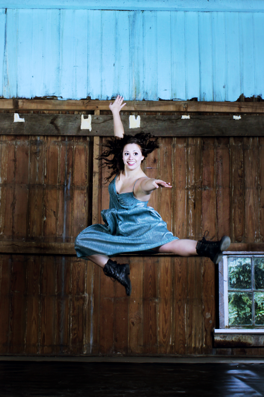TMP's Megan Lee Gargano leaps in the company's barn space. Photo by Bryce Millikin.