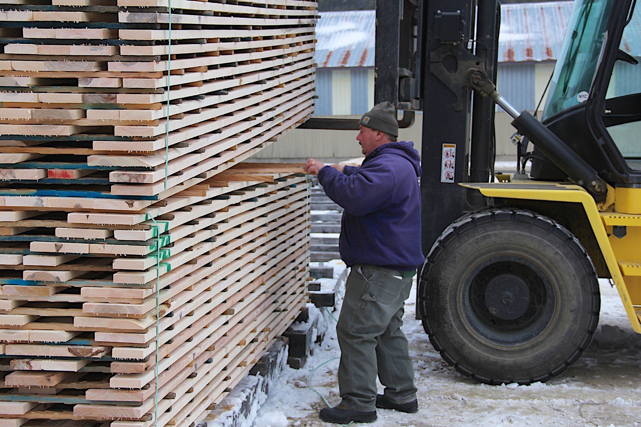 Getting the wood ready to be loaded.jpg