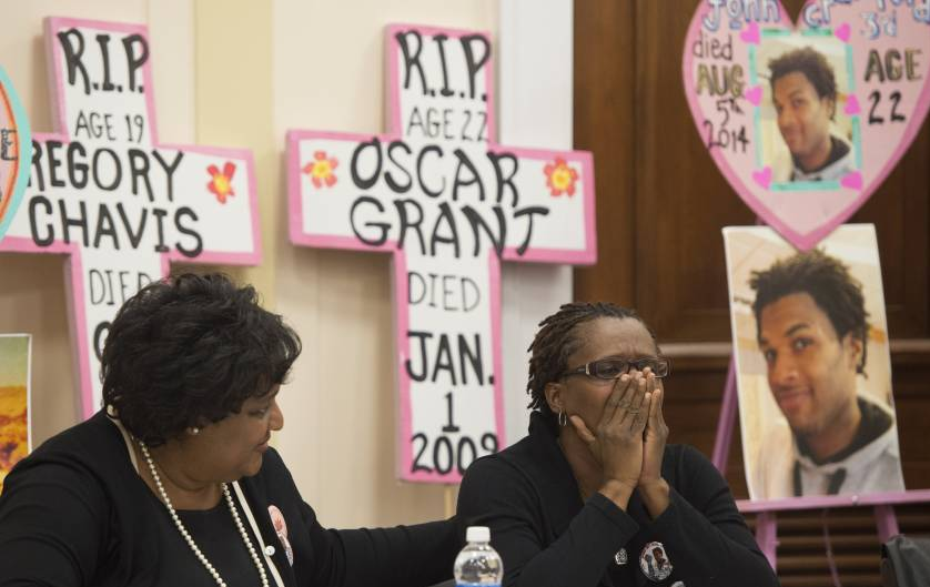 Collette Flanagan (L), mother of 25-year-old Clinton Allen who was shot and killed by a Dallas policeman, comforts Tressa Sherrod (R), mother of 22-year-old John Crawford III who was shot and killed by police in an Ohio Walmart, as they join other mothers who have lost children due to police action during a press conference calling for police accountability and reform on Capitol Hill in Washington, DC, December 10, 2014.