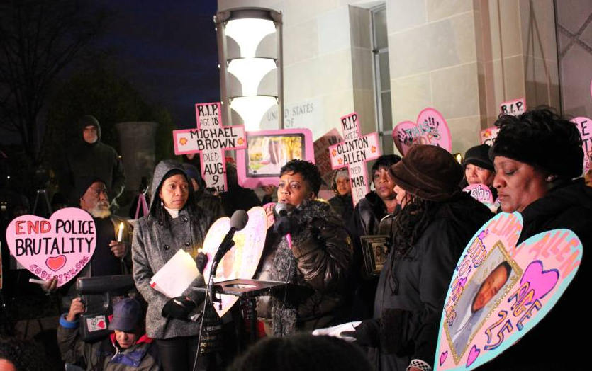 Demonstrators with Mothers Against Police Brutality gather for a candle light vigil in front of the US Justice Department in Washington, DC, December 10, 2014.