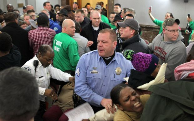 Wanda Brandon cries out as St. Louis Police Sgt. Brian Rossomanno moves people out of the way as a meeting of a proposed civilian oversight review board got out of control at City Hall on Wednesday, Jan. 28, 2015. Photo by Robert Cohen, rcohen@post-dispatch.com