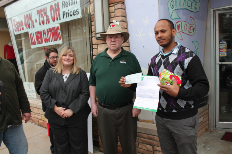 North County Inc. President and CEO Rebecca Zoll, former Ferguson Mayor Brian Fletcher and WIN Wireless owner Nebeyou Teffera stand in front of the I Love Ferguson store. Fletcher is running for the 2nd Ward City Council seat.  CREDIT JASON ROSENBAUM, ST. LOUIS PUBLIC RADIO