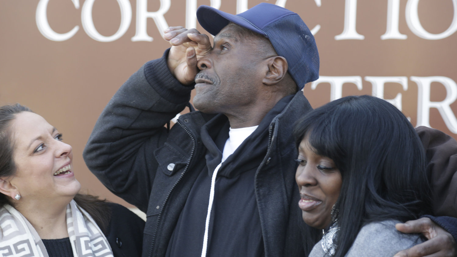 Stanley Wrice pauses in December 2013 as he speaks to the media with his lawyer, Heidi Linn Lambros (left), and his daughter, Gail Lewis, while leaving Pontiac Correctional Center in Pontiac, Ill. Wrice was released after serving more than 30 years. He claimed for decades that Chicago police detectives under the command of then-Lt. Jon Burge beat and coerced him into confessing to rape.   M. Spencer Green/AP