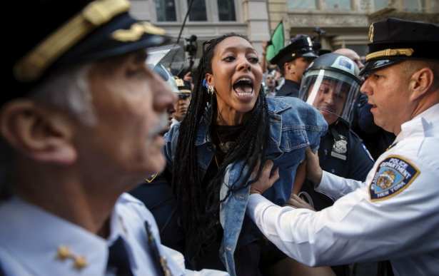 NYPD officers detain a protester during a march in solidarity with Baltimore on April 29, 2015. (Reuters/Mike Segar)