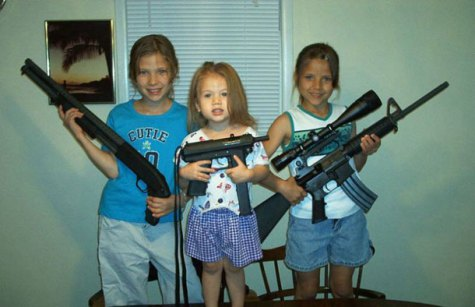 white kids posing with high-powered weapons.